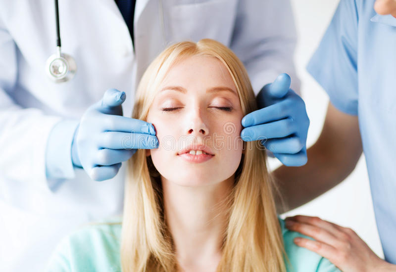 Plastic surgeon and nurse with patient royalty free stock images