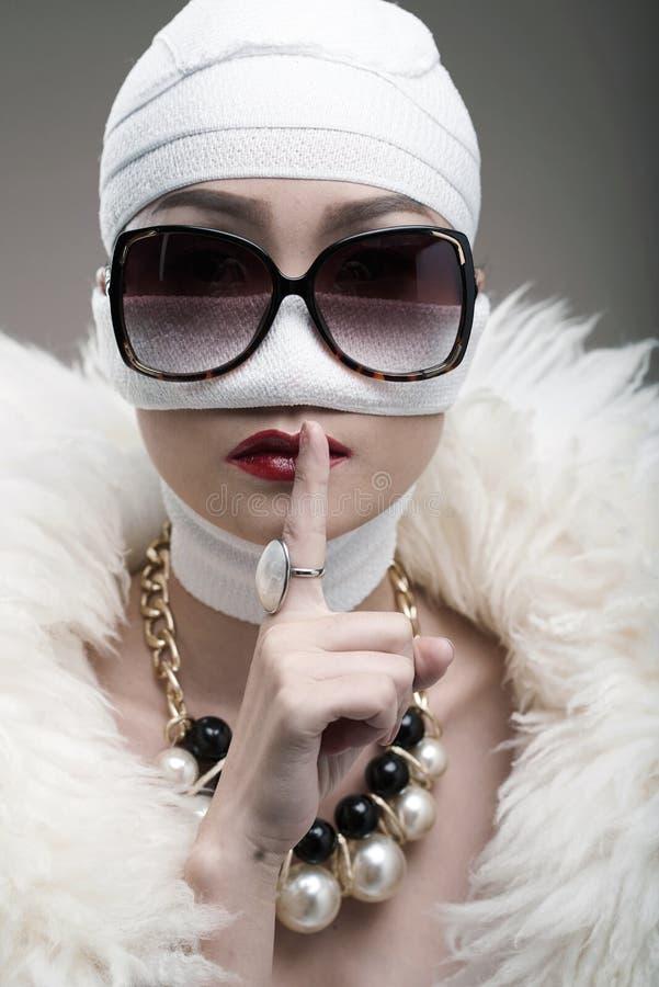 Plastic surgery. Diva keeping secret of her plastic surgery royalty free stock photos