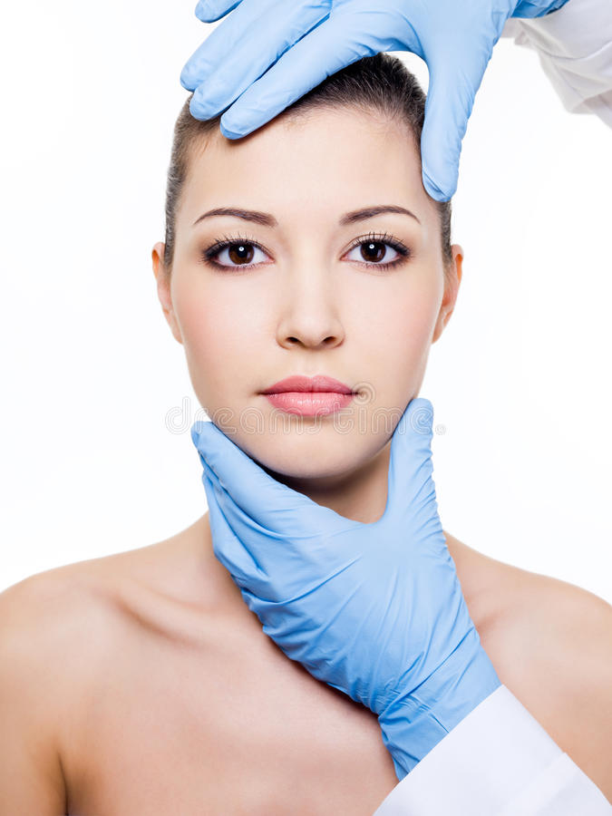 Plastic surgery touching the woman face royalty free stock images