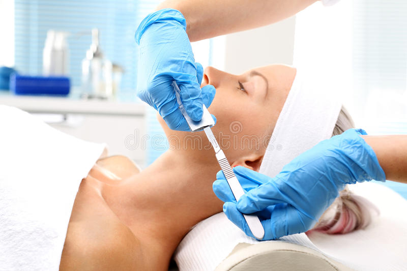 Plastic surgery, a woman in a plastic surgery clinic. royalty free stock photos