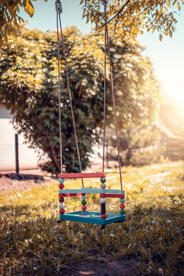 Plastic swing in the park. Colorful plastic swing in the park stock images
