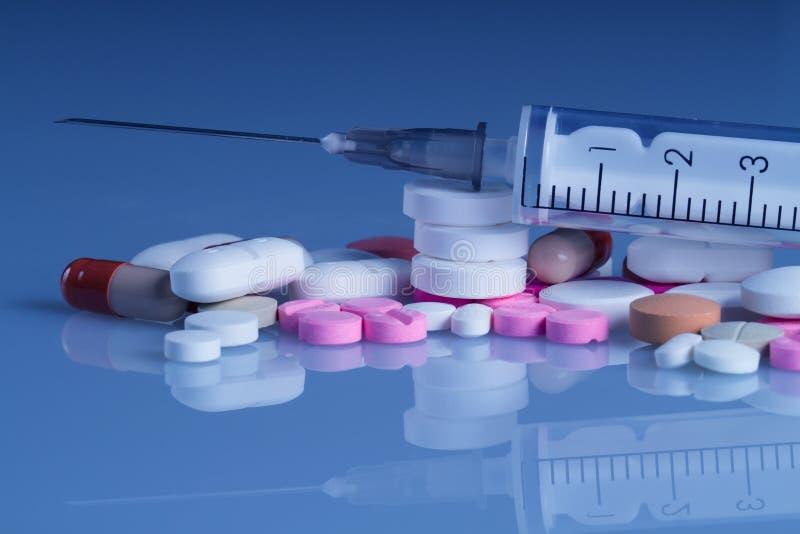 Plastic syringe and pills
