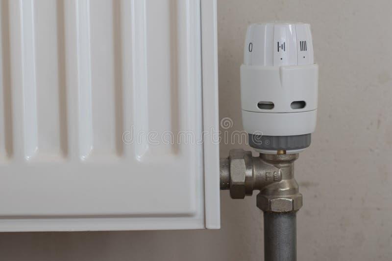 Plastic temperature regulator on battery stock photography