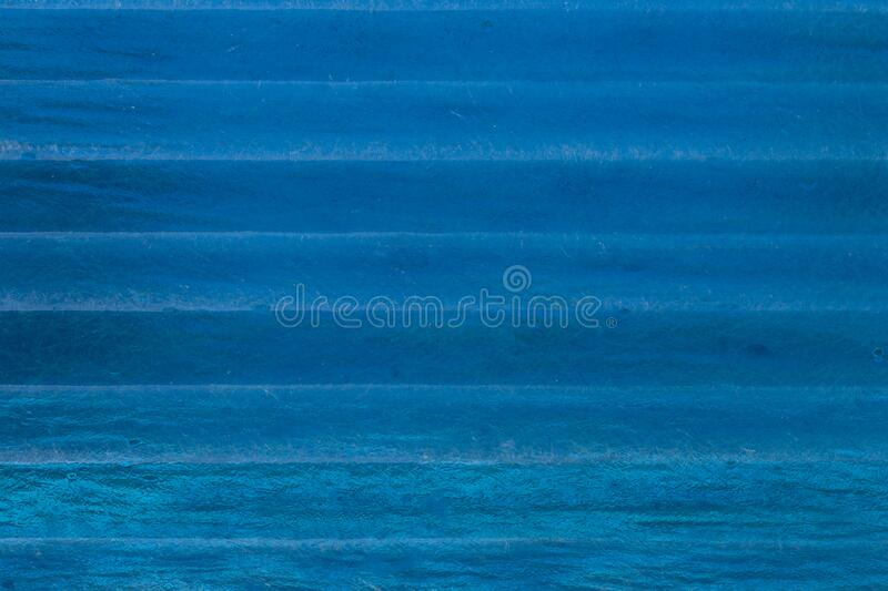 Plastic texture with blur effect in navy blue color.  stock image