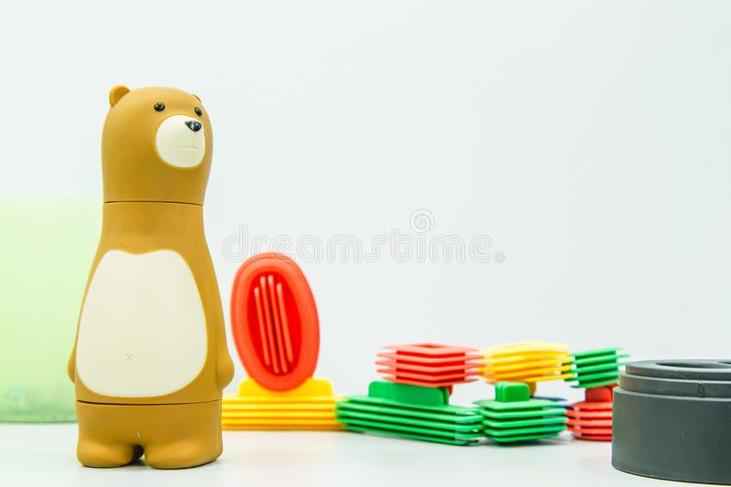Cute plastic toy bear on table stock images