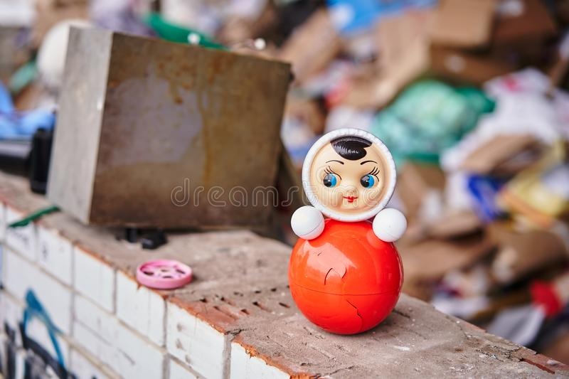 Plastic toy among the heaps of garbage royalty free stock photography
