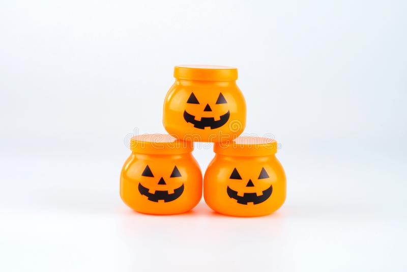 Plastic toy jack-o-lantern pumpkin for halloween decoration isolated on white background royalty free stock images