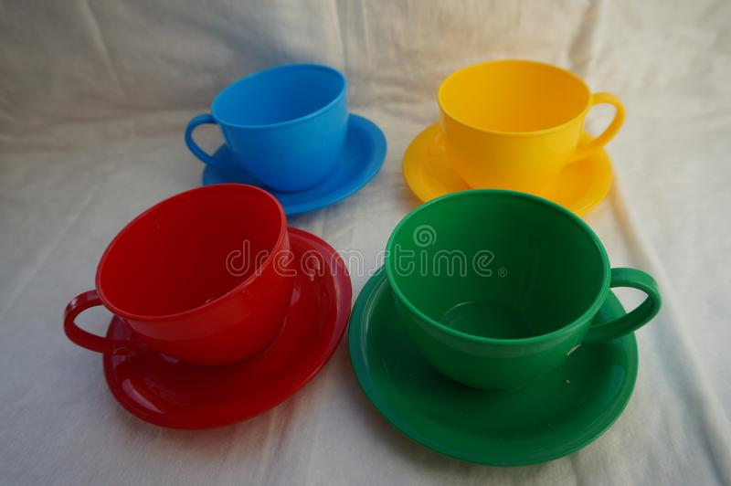 plastic toy multicolored mugs royalty free stock photography