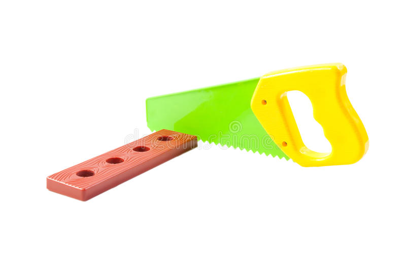 Plastic toy saw and lath isolated on white. Background stock images
