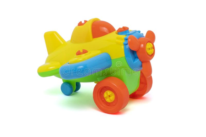 Plastic toys for baby. Plastic colors toys, little plane for baby on white background stock photo
