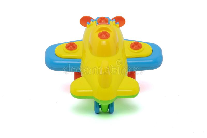 Plastic toys for baby. Plastic colors toys, little plane for baby on white background royalty free stock images