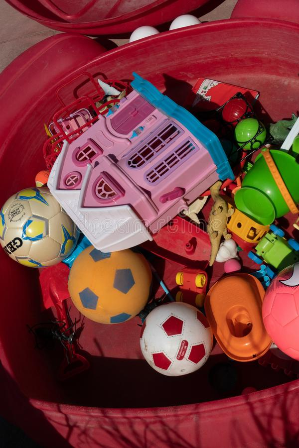 Plastic toys and balls. Rome, Italy - August 11, 2018: Large amount of plastic toys and balls stock image