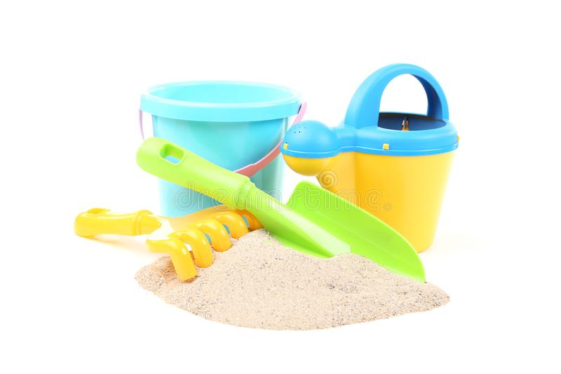 Plastic toys with beach sand. Isolated on white background stock photo