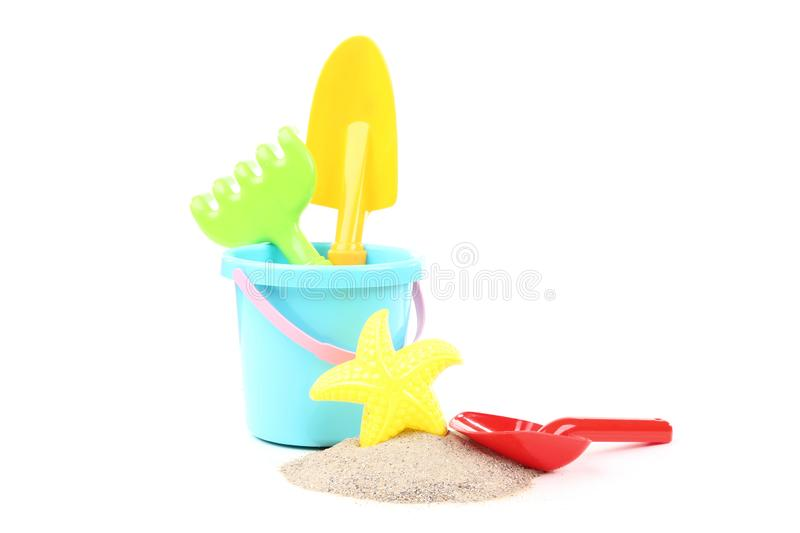 Plastic toys with beach sand. Isolated on white background royalty free stock photo