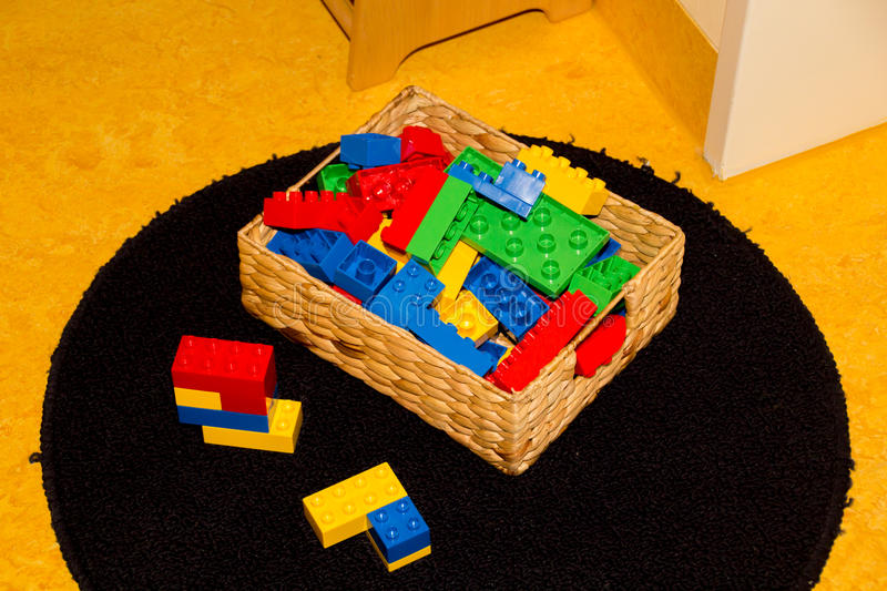 Plastic toys in box. In a childrens room ready to play with royalty free stock image