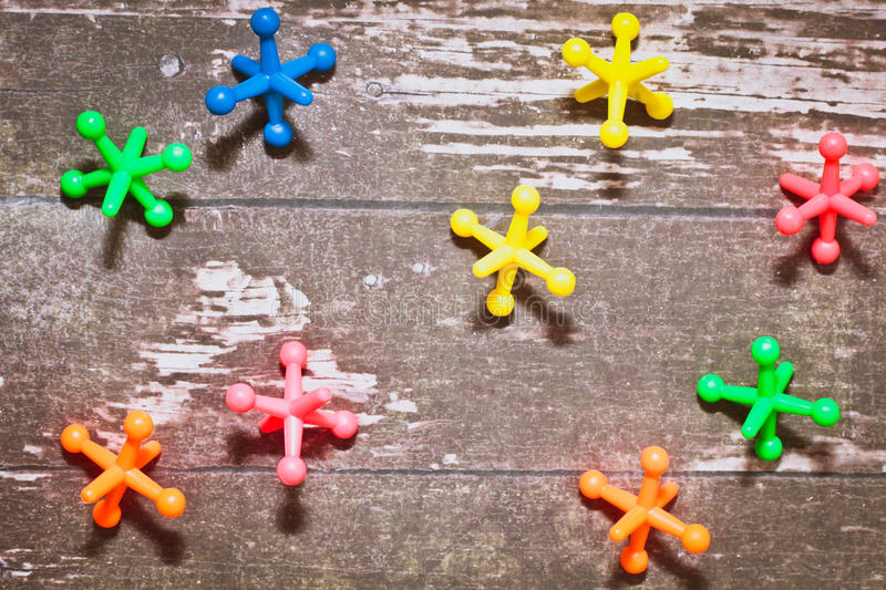 Plastic toys. Colorful plastic toys on a wooden surface stock photos
