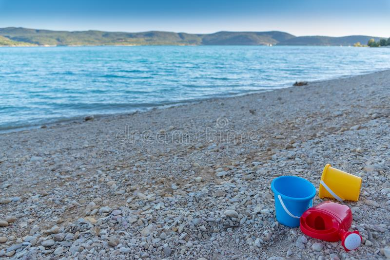 Plastic toys. On a beach royalty free stock images