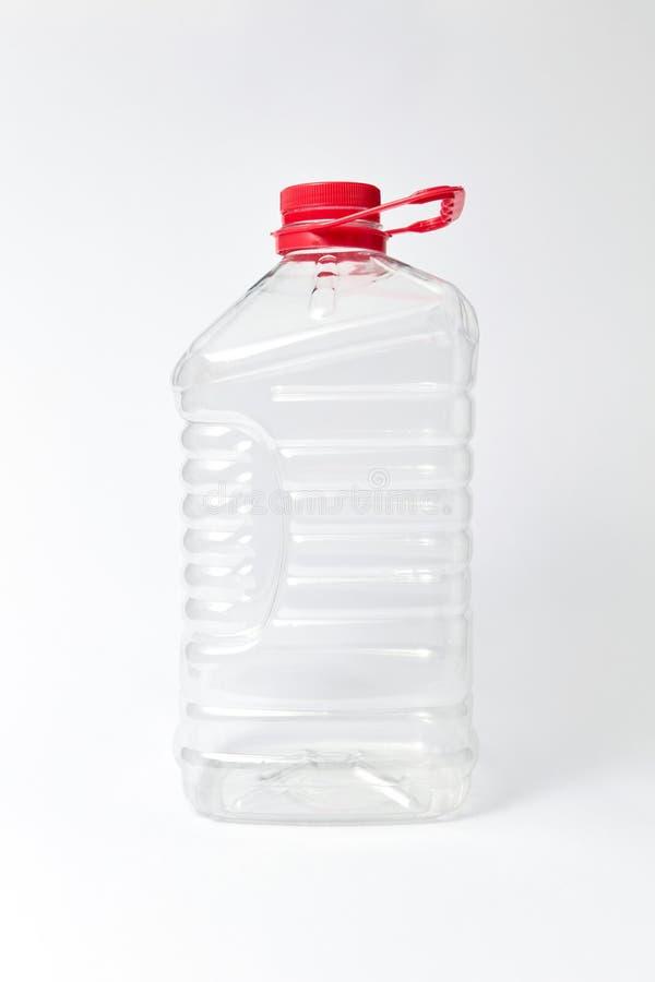 Plastic transparante bus voor water op licht bakground Spot omhoog stock afbeelding