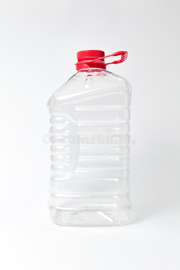 Plastic transparent canister for water on a light bakground. Mock up. stock image