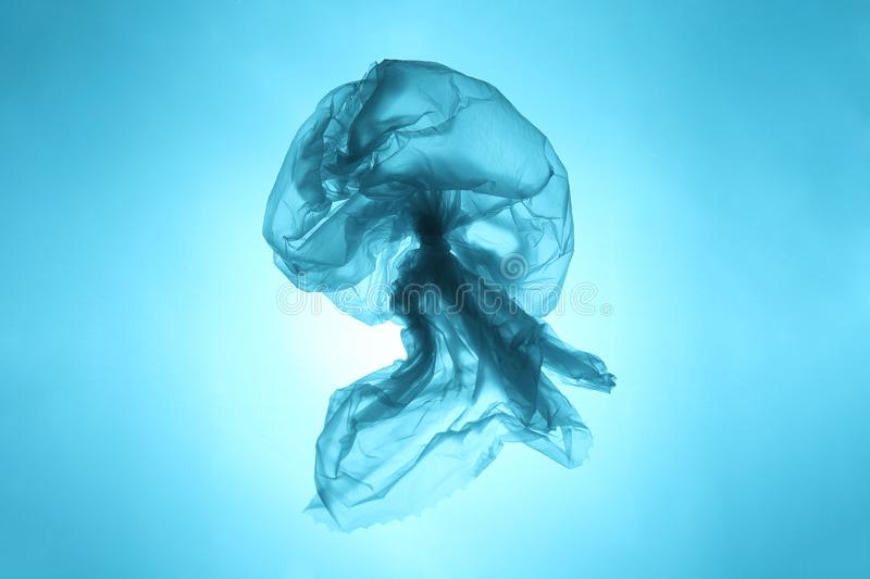 Plastic trash in the oceans of the planet. Ocean blue jellyfish from a plastic bag. The destruction of the ecosystem royalty free stock photos