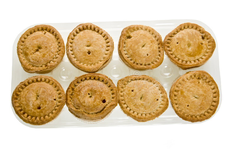 A plastic tray of pork pies royalty free stock photo