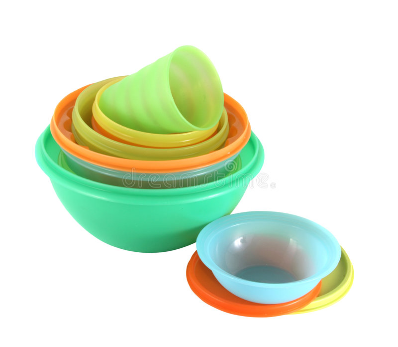 Plastic utensils. Pile of plastic plates, bowls and glasses of different color royalty free stock photos