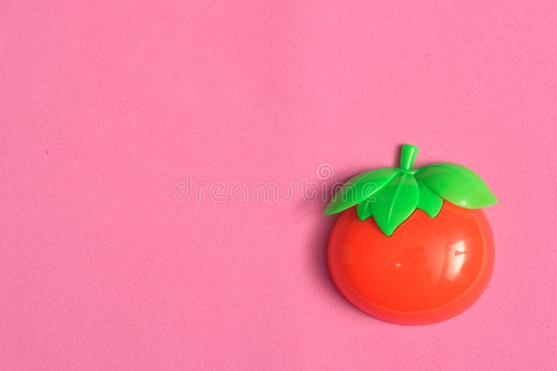 Plastic vegetable collection set of one tomato on isolated pink background royalty free stock image