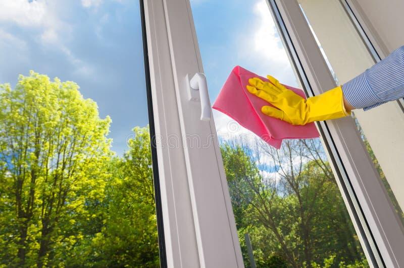 Plastic vinyl window. Cleaning vinyl plastic window on a background blue sky stock image