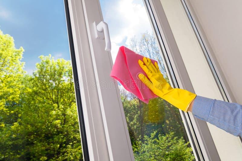 Plastic vinyl window. Cleaning vinyl plastic window on a background blue sky royalty free stock photo