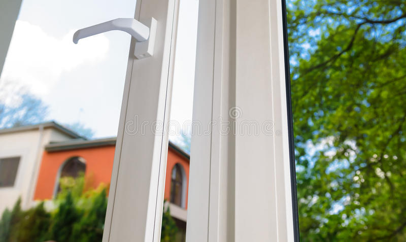 Plastic vinyl window. Open plastic vinyl window on a background blue sky royalty free stock photo