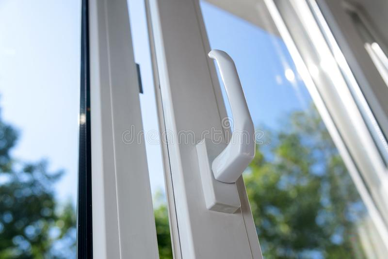 Plastic vinyl window. Opened plastic vinyl window on a background blue sky stock photo