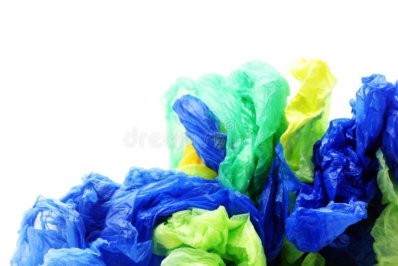 Plastic vuilniszakken op witte achtergrond royalty-vrije stock afbeeldingen