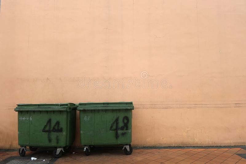 Plastic waste bin on road side royalty free stock photography