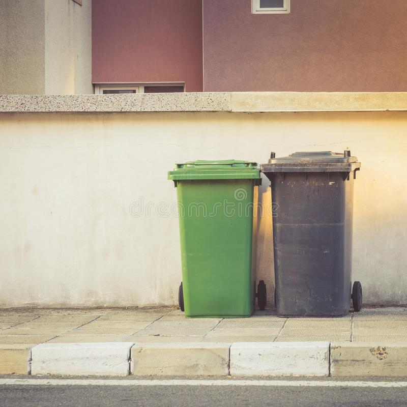 Plastic waste containers on the street ready for collection royalty free stock photos