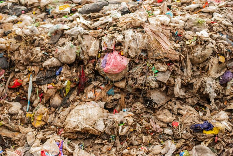 Plastic waste is difficult to handle, resulting in pollution and high costs. royalty free stock photography