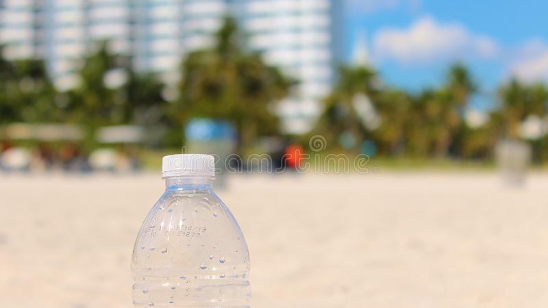 Plastic Water Bottle on the Beach royalty free stock photography