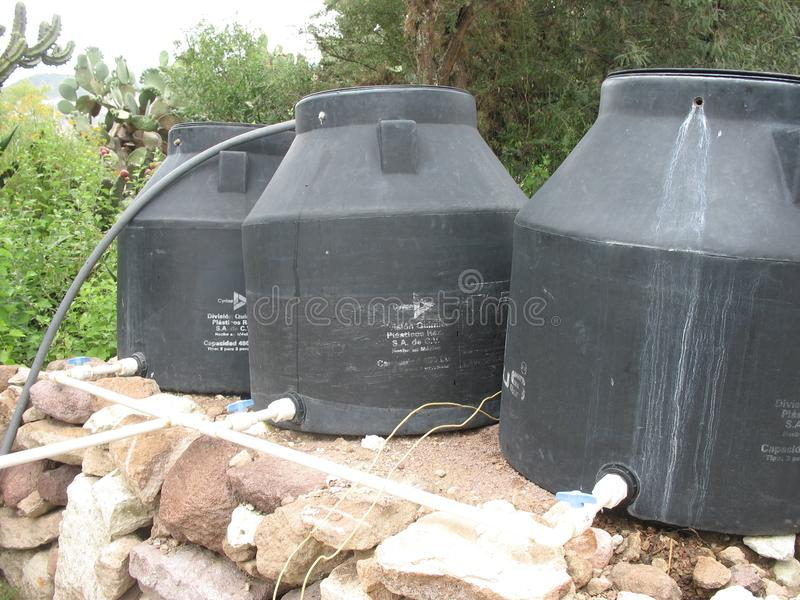 Plastic water tanks being dried on the rocky background. Produced by a cooperative in Central America being dried on the roof in Cuetzalan Puebla stock photo