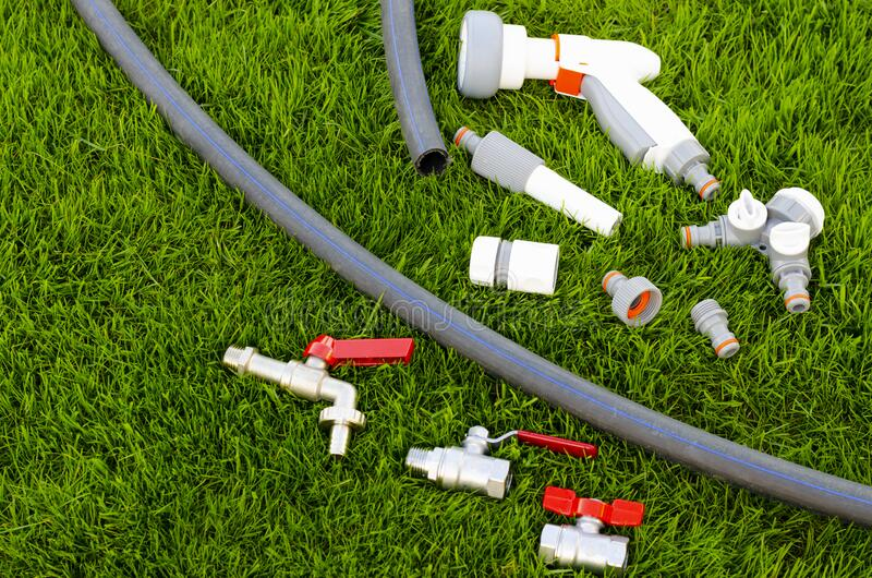 Plastic, watering can, hose for watering the garden, lawn. royalty free stock images