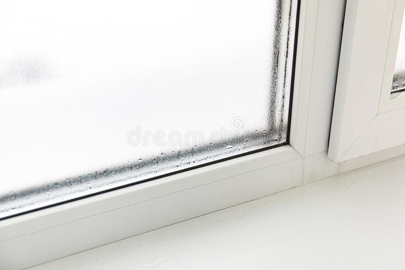 Plastic window with damp and water condensation on glass royalty free stock photos