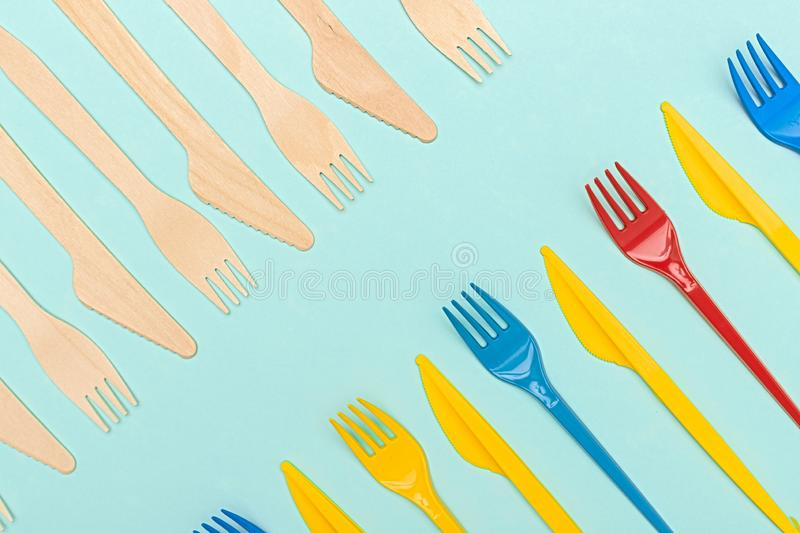 Plastic and wooden tableware stock images
