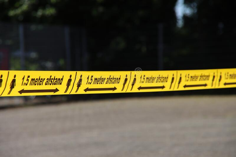 Plastic yellow tape with in dutch language 1,5 meter Afstand to keep people o stock photos
