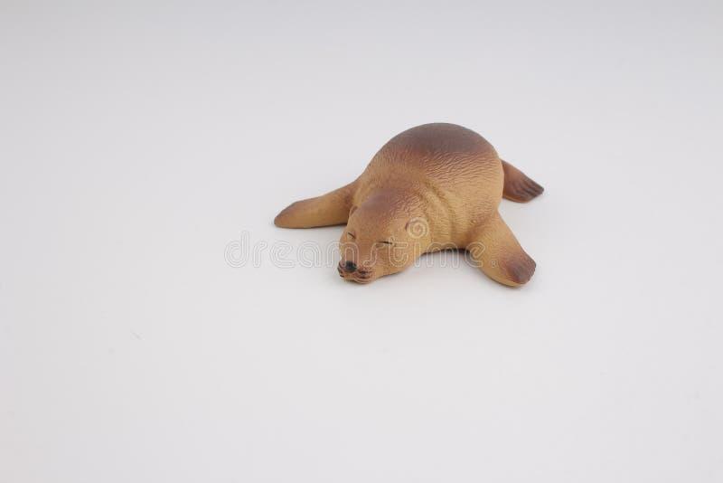 Plastic zeeleeuw, stuk speelgoed met cijfer royalty-vrije stock fotografie