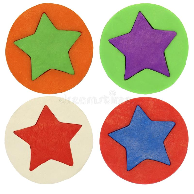 Plasticine badges with stars stock images