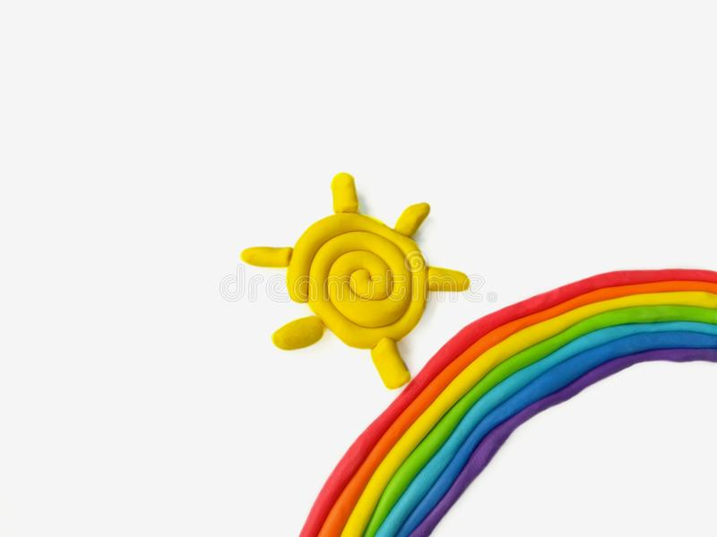 Plasticine bonito do arco-íris e do sol imagens de stock royalty free