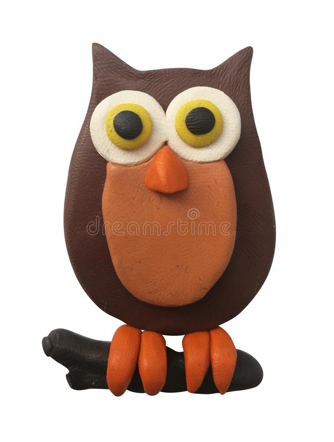 Plasticine brown owl. Halloween design. Isolated on white royalty free stock image