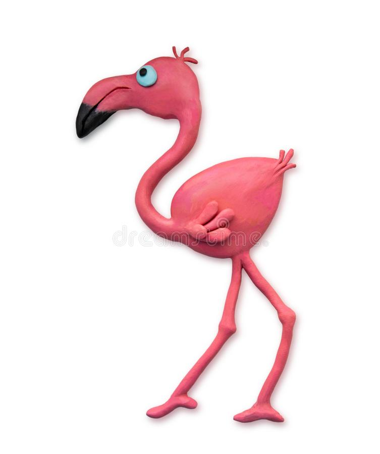 Plasticine cartoon flamingo closeup isolated on white background. Plasticine bird cast by hand. View from above. Crafts from. Plasticine cartoon flamingo closeup royalty free stock photography