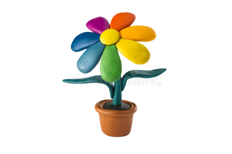Plasticine colorful flower with leaves in brown pot stock photo