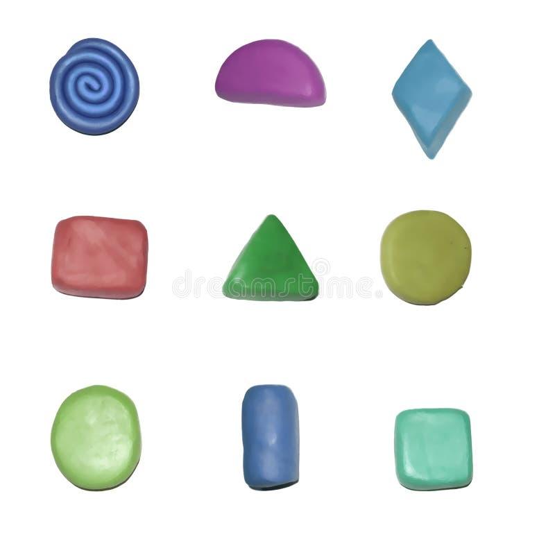 Plasticine geometric figures stock images
