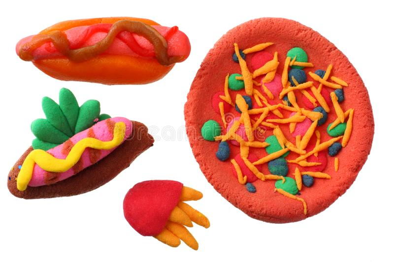 Plasticine hot dog, pizza, French fries isolated on white background. modelling clay royalty free stock image