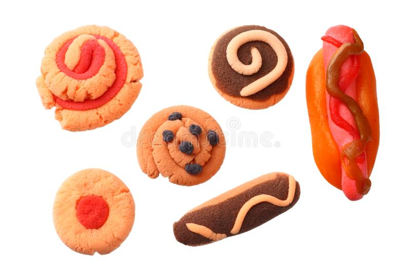Plasticine hot dog with sweets isolated on white background. modelling clay stock photos